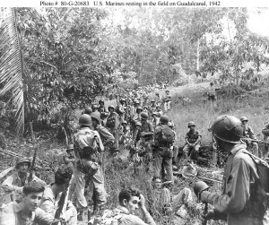 U.S. Marines resting in a field on Guadalcanal, 1942. Photo credit US Navy.