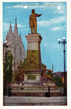 Post Card image of the Pioneer Monument in Salt Lake City with the Mormon Church in the background.