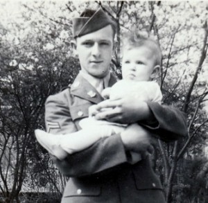 Stanley Murawski home in Albany on furlough in May of 1943. He had a 2 1/2 day train ride from Ephrata Army Air Base in Washington State to get home. Here he meets his niece Theresa-Marie for the first time. She was born after he was called up the previous October.