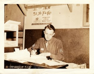 "Stanley Murawski working at his desk at Great Falls Army Air Base. In his letter he notes ""I sure had a mess of papers on my desk."""