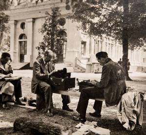 Willim L. Shirer (l. on bench) reporting from France in 1940.