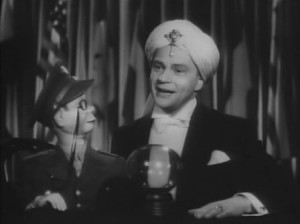 Renowned ventriloquist Edgar Bergen and his sidekick Charlie McCarthy in the movie Stage Door Canteen.