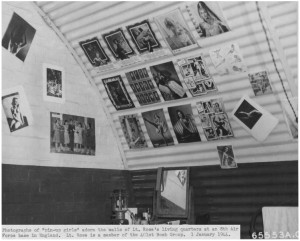 Photo of a barracks at Deenthorp with a collection of Pin Up girls on the wall. Image courtesy of http://www.remember-our-heroes.nl/us_401stBG.htm